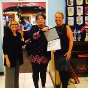 Beth McGinn, Home of the Brave (center), receives award from Judy Hall (left) and Paulette Rappa (right)