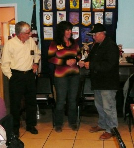 Austin Govin Commander of American Legion Post 28 receives $500 check from Mike and Judy