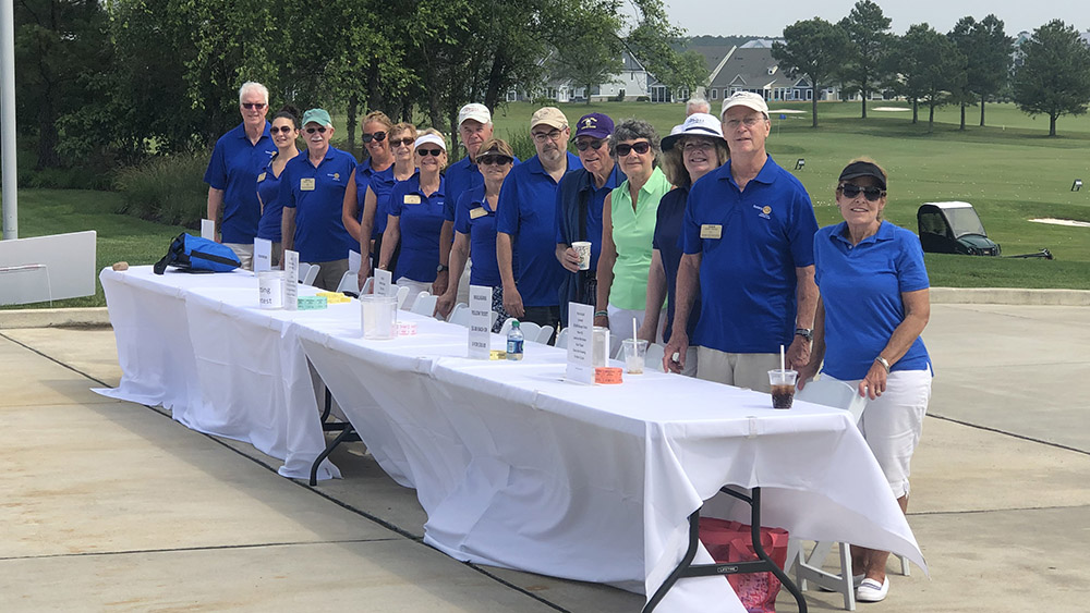 photo of club members at golf outing registration desk