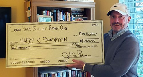 Photo of John Berner and donation check
