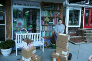 Alex Colevas, Browseabout Books, readies book shipment for pick up by Long Neck Sunrise Rotary Club.